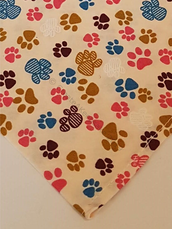 Personalised Pet Bandana - cream bandana with multicoloured paws pattern