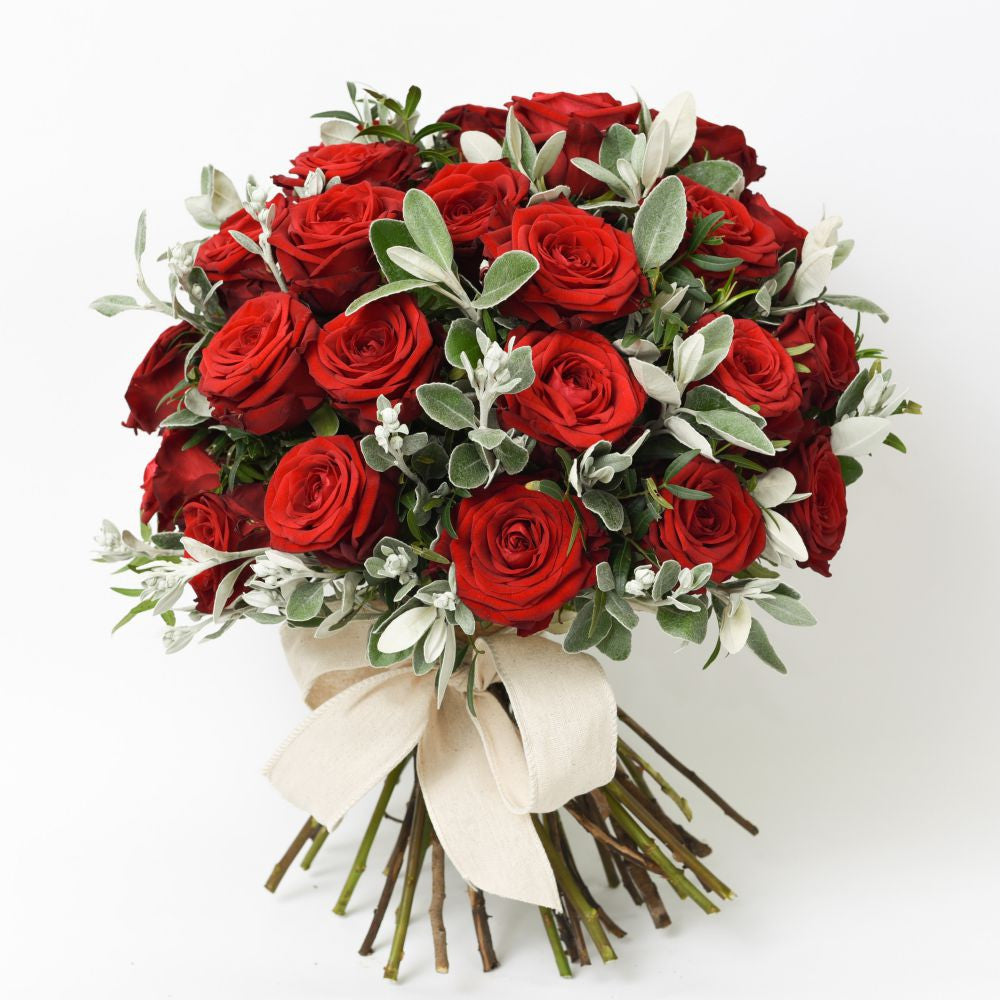 hand tied freshly cut red rouses bouquet with white ribbon