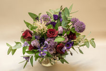 Botanical elegance bouquet of violet and red flowers in a vase