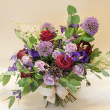 Huge botanical bouquet of violet and red flowers with greenery