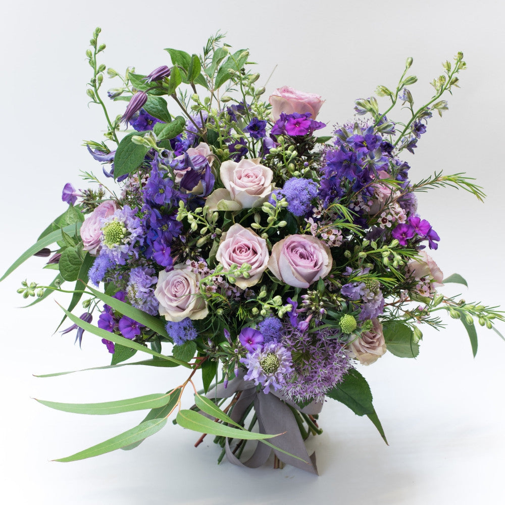 Beautiful pale lilac roses and green foliage bouquet