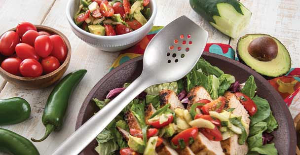 RADA stainless steel chef's spoon over a plate of chicken salad and sliced avocado