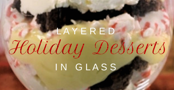 Wine glass layered with peppermint flakes, brownies and ice cream