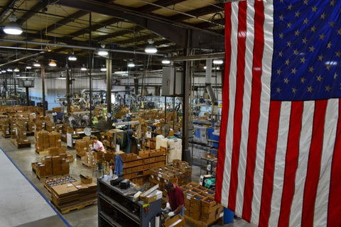 A day at RADA Manufacturing's factory in Waverly, Iowa as our employees work with an American flag in the foreground to the right