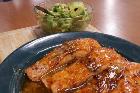 Avocado and grapefruit salsa spread glazed over filets of delicious salmon
