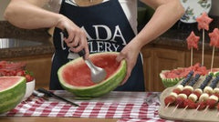 Kristi Kay scooping out a large watermelon with the RADA Ice Cream Scoop