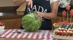 Kristi slicing a large watermelon with the RADA Ham Slicer