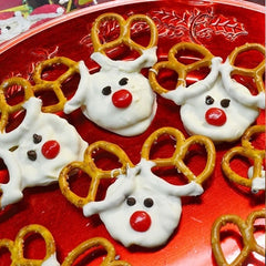 Some red nosed reindeer treats with pretzel antlers laid out on red platter