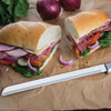 "10"" Bread Knife in front of a halved sub sandwich"