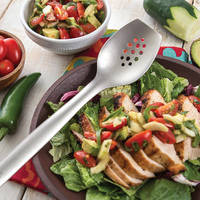 Cook's Spoon w/Holes on top of a sliced chicken salad