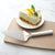 Rada Cutlery Serrated Pie Server with silver handle and slice of lemon pie.