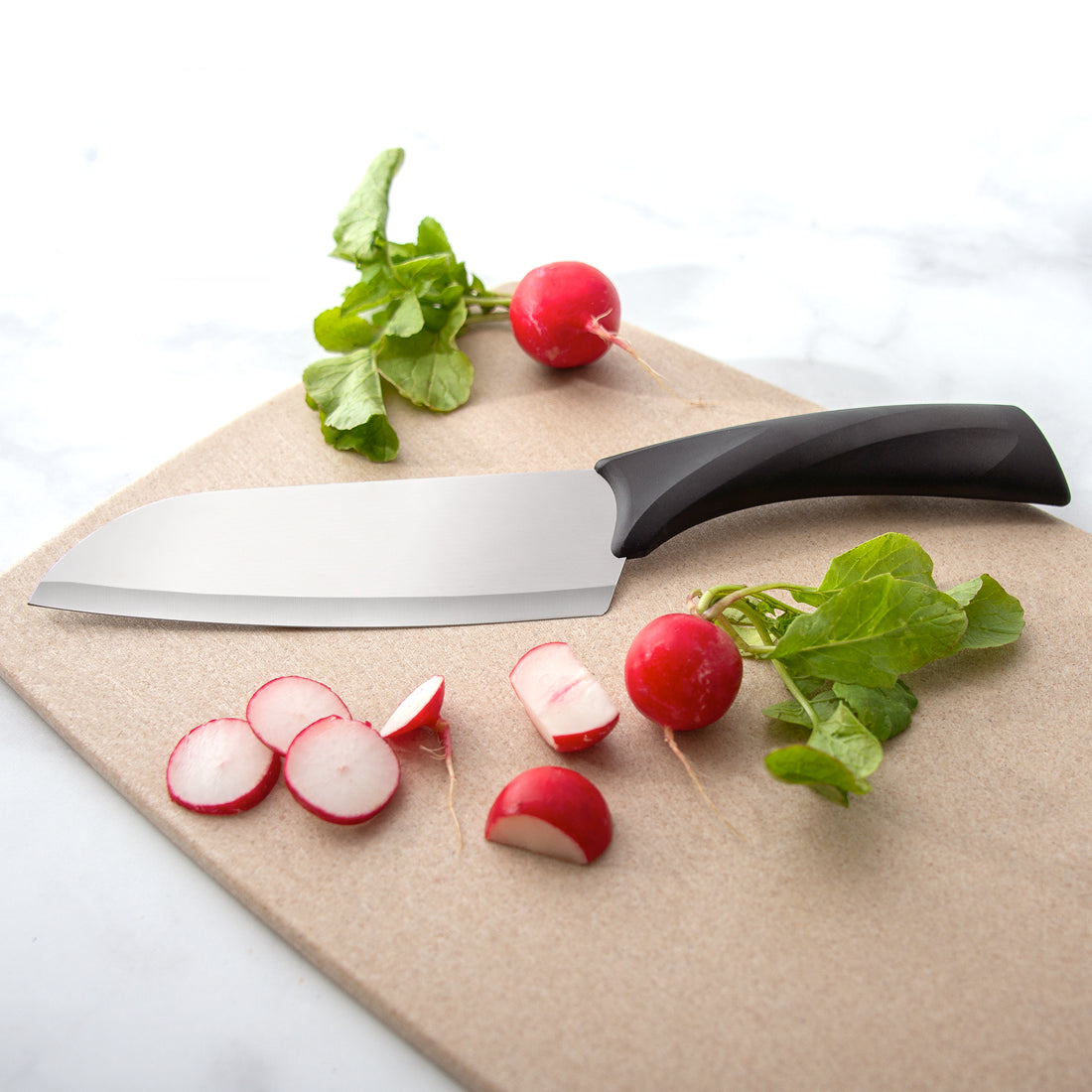Rada Cutlery Anthem Wave Cook's knife on cutting board with radishes.