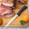 Rada Cutlery Anthem Wave Slicer on cutting board with sliced meat.