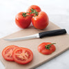 Rada Cutlery Anthem Wave Tomato Slicer with sliced tomatoes.