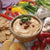 Applewood Smoked Bacon Dip mix served with crackers and vegetables.