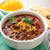 Black Bean Chili in bowl garnished with cheese.