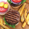 Burger & Fry Seasoning on hamburger served with french fries.