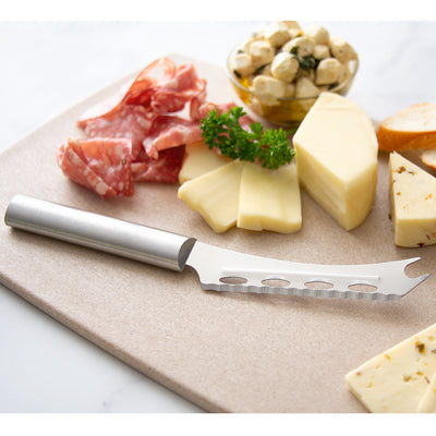 Cheese knife with silver handle and an assortment of cheese.