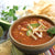 Chicken Tortilla Soup in bowl garnished with parsley.