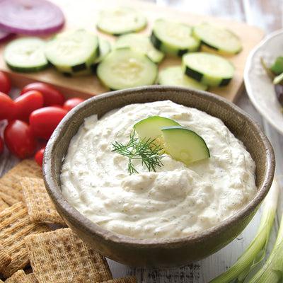Cucumber Onion Dill Dip mixed with sour cream and served with crackers and veggies.