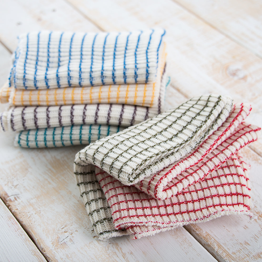 Stack of woven multi-colored dishcloths.