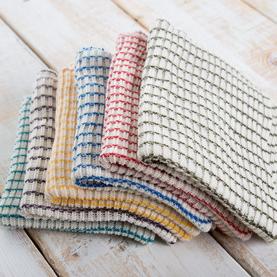 Pile of six woven multi-colored dishcloths.