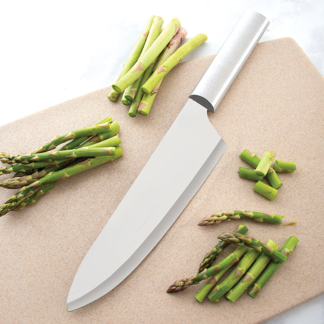 Rada Cutlery French Chef Knife with black handle and minced herbs