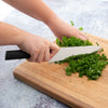 French Chef knife in use mincing herbs.