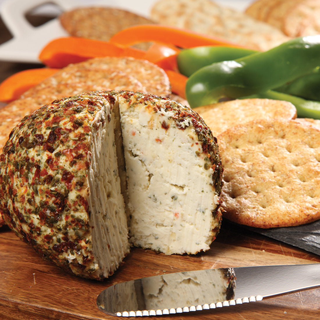 Garden Vegetable Cheeseball with spices and cream cheese served with crackers.