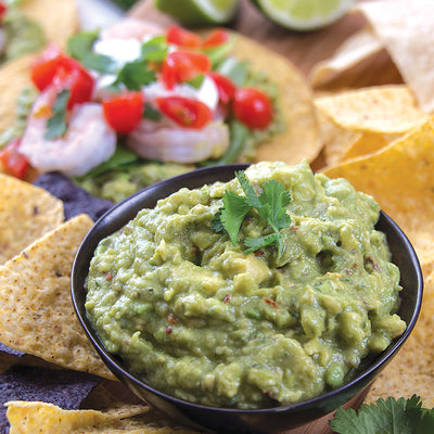 Guacamole Dip mix mixed with avocados and served with tortilla chips.