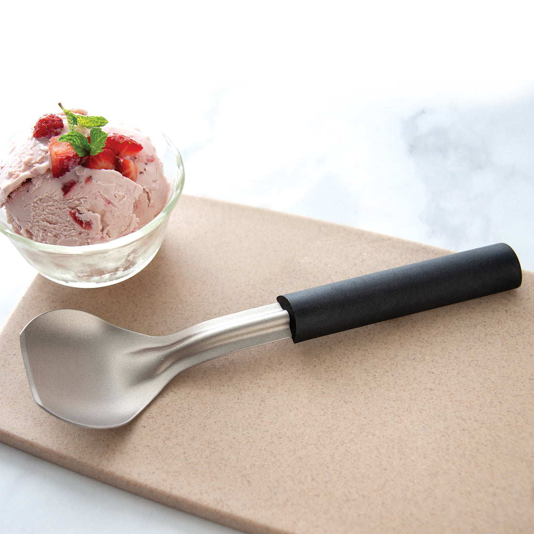 Rada Cutlery Ice Cream Scoop with black handle and stainless steel shaped bowl.