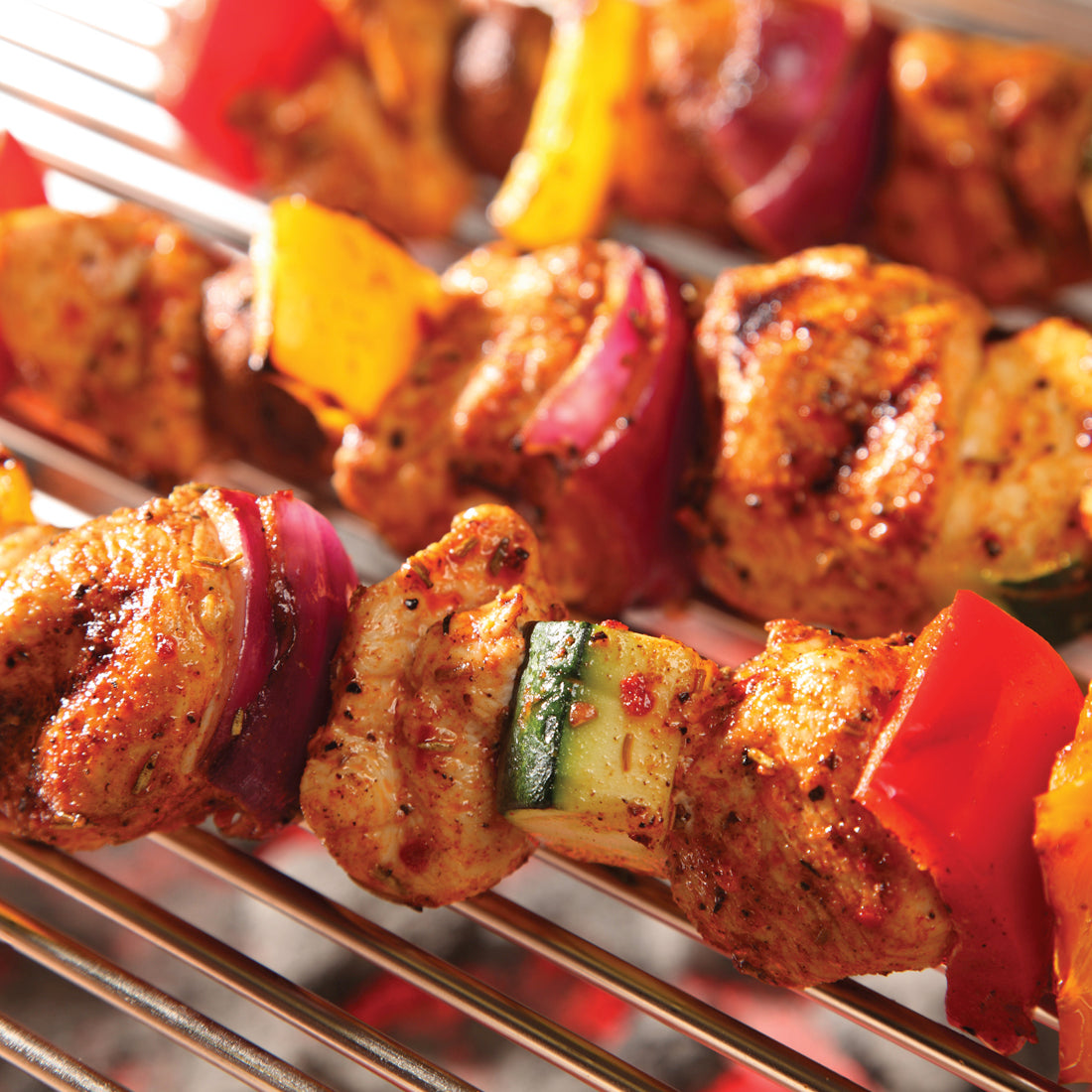 Jamaican Jerk Marinade shown on chicken and vegetable kabobs.