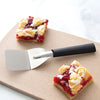 Rada Cutlery Mini Server with black handle on cutting board with cherry bars.
