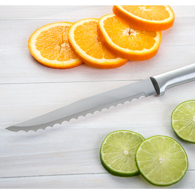 Serrated Slicer with silver handle next to sliced citrus fruits.