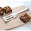 Serverspoon spatula shown on cutting board with brownies.