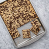 Nonstick sheet pan with easy-grab handles showing chocolate chip cookie bars.