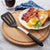 Rada Cutlery nonscratch Slotted Turner resting next to eggs, bacon and toast.