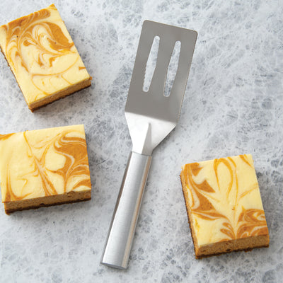 Rada Cutlery Spatula with silver handle and pumpkin cheesecake squares.