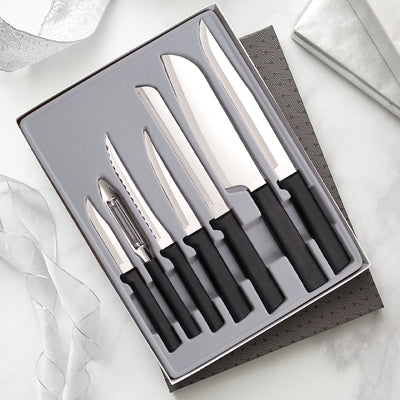 The Starter Gift Set with black handles with six knives and a vegetable peeler in gift box.