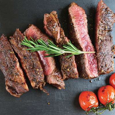 Steak & Chop Seasoning shown on sliced steak.