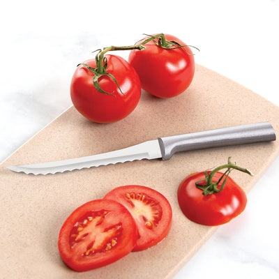 Rada Cutlery Tomato Slicer knife with silver handle and sliced tomatoes.