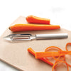 Vegetable Peeler with silver handle and peeled carrots.