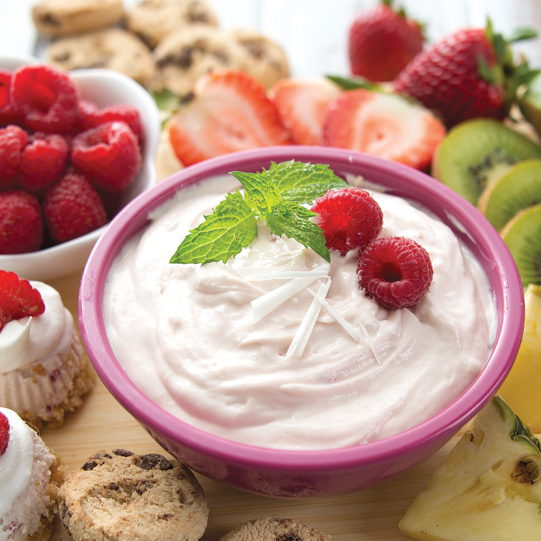 White Chocolate Raspberry Sweet Dip garnished with raspberries and mint.