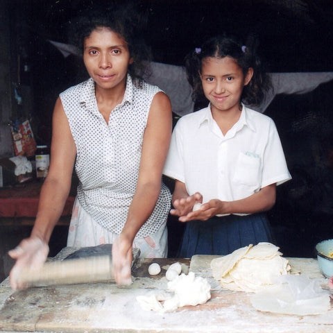 Give a gift that matters: a donation in your friend's name. With a $25 loan, a Honduran mother can sell more tortillas, increase her profit and keep her childre