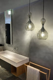 Pair of Blubb Pendants with Black Cable shade in Chrome finish in a bath setting