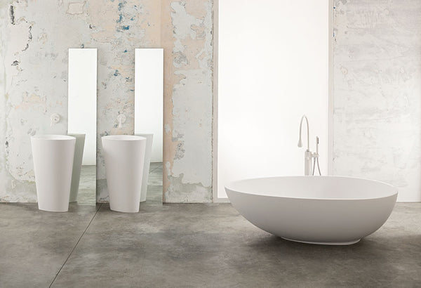 Body Floor Standing Sinks with Vov Free standing bathtub in cristalplant from Mastella  Contemporary bathroom setting