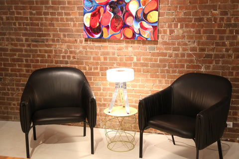 Pair of Celine Lounge Chairs in Black Leather with  Fino Table Lamp in the middle