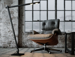 Squadrone Floor Lamp from Byok in Black Finish with armchair setting