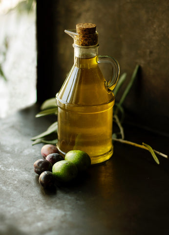 extra-virgin-olive-oil-and-olives-on-table-momental-nootropics