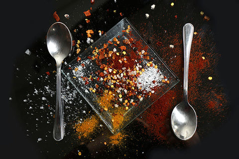 black-plate-of-spice-between-two-spoons-momental-nootropics